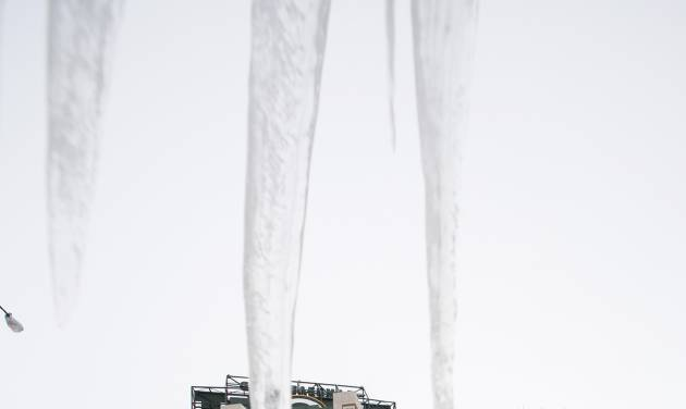 Icicles are seen outside Lambeau Field as fans tailgate before an NFL wild-card playoff football game between the Green Bay Packers and the San Francisco 49ers, Sunday, Jan. 5, 2014, in Green Bay, Wis. (AP Photo/Jeffrey Phelps)