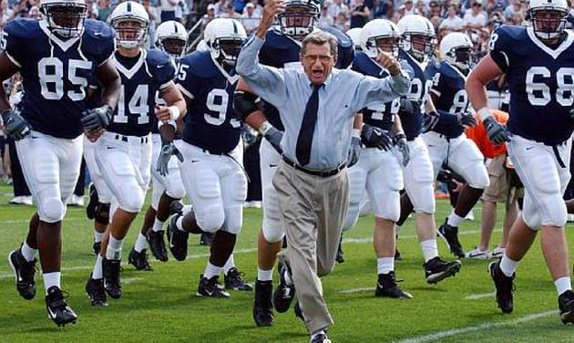 Penn State coach Joe Paterno leads his team onto the field before the game against Akron on Saturday, Sept. 4, 2004, in State College, Pa. Penn State won 48-10. (AP Photo /Carolyn Kaster)