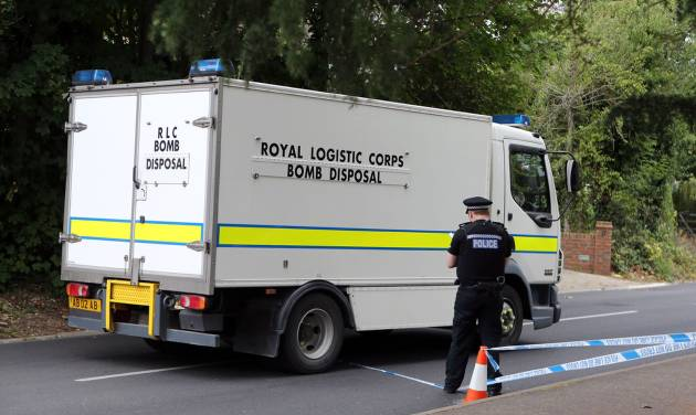 A Royal Logistic Corps bomb disposal truck close to the home of Saad al-Hilli, in Claygate, England, who was shot dead with three others while vacationing in the French Alps, Monday Sept. 10, 2012. UK police say they have evacuated homes near the house of a British-Iraqi couple slain while vacationing in the French Alps because of concerns about items found at the property. (AP Photo/PA, Steve Parsons) UNITED KINGDOM OUT NO SALES NO ARCHIVE