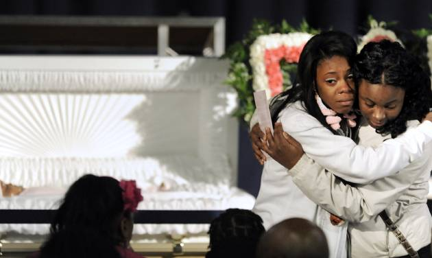 Family members mourn next to the casket of 6-month old Jonylah Watkins during her funeral at New Beginnings Church in Chicago, Tuesday, March, 19, 2013.  Watkins was killed when a gunman fired at a minivan as she sat on her father's lap on March11.  (AP Photo/Paul Beaty)