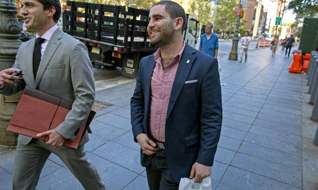 Charles Shrem, center, the top executive of a New York City-based Bitcoin company, walks from the federal court house in New York Thursday, Sept. 4, 2014, after pleading guilty to federal charges that he helped smooth the way for drug transactions on the online marketplace Silk Road. (AP Photo/Craig Ruttle)