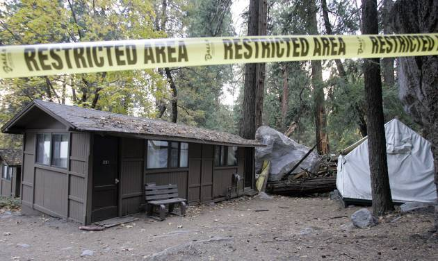 FILE - In this Monday, Oct. 20, 2008 file photo, restriction tape blocks an area at Curry Village in Yosemite National Park, Calif., after a boulder fell during a rock slide. Falling boulders are the single biggest force shaping Yosemite Valley, one of the most popular tourist destinations in the nation's system of national parks. Now large swaths of popular haunts deemed unsafe are closing as officials acknowledge they knew for more than a decade ago that unsuspecting tourists were being lodged in harm's way. On Thursday, June 14, 2012, the National Park Service will announce that potential danger from the unstable 3,000-foot-tall slab of granite known as Glacier Point, a picturesque promontory that for decades has provided a dramatic backdrop to park entertainment events, will leave uninhabitable large parts of Yosemite Valley's most popular lodging areas. (AP Photo/Paul Sakuma)