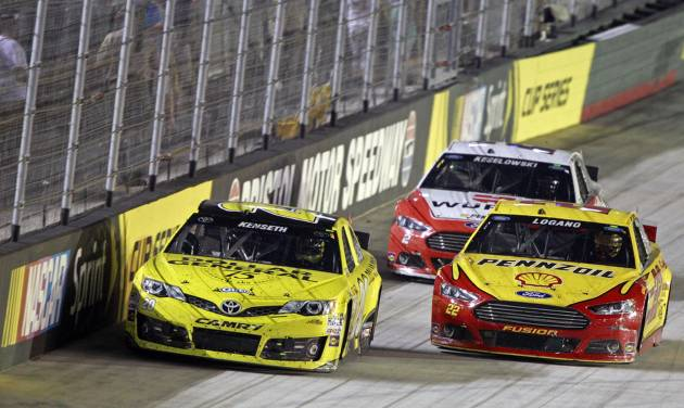 Matt Kenseth (20) and Joey Logano (22) battle for the lead as Brad Keselowski (2) trails during a NASCAR Sprint Cup Series auto race at Bristol Motor Speedway on Saturday, Aug. 23, 2014, in Bristol, Tenn. (AP Photo/Wade Payne)