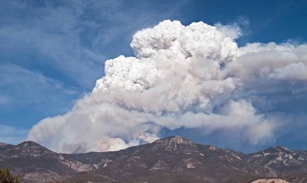 This Tuesday, May 22, 2012, photo, provided by David Thornburg shows a plume of smoke rising from the Whitewater fire burning in the Gila Wilderness east of Glenwood, N.M. Fire managers said the blaze had charred more than 10,000 acres before merging Wednesday afternoon with the nearby 11,500-acre Baldy fire. Both fires were sparked by lightning. (AP Photo/David Thornburg)