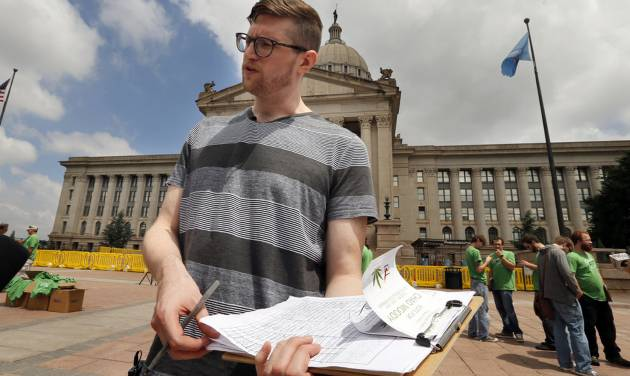 David Barham, of Tulsa, asks for signatures May 28, 2014, at the Oklahoma Capitol on a petition to get an initiative put on the state ballot regarding medical marijuana. Photo by Steve Sisney, The Oklahoman Archives