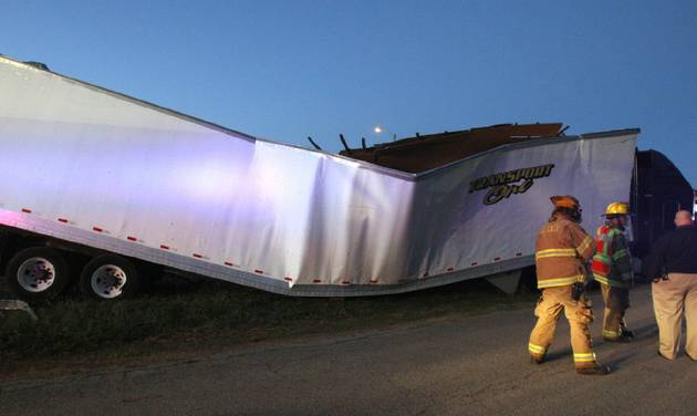 A tractor-trailer in the 4000 block of SE 9 in Del City went through a building under construction after driving off Interstate 40 Thursday. The driver of the tractor-trailer died. Photo by Paul B. Southerland, The Oklahoman   PAUL B. SOUTHERLAND - PAUL B. SOUTHERLAND