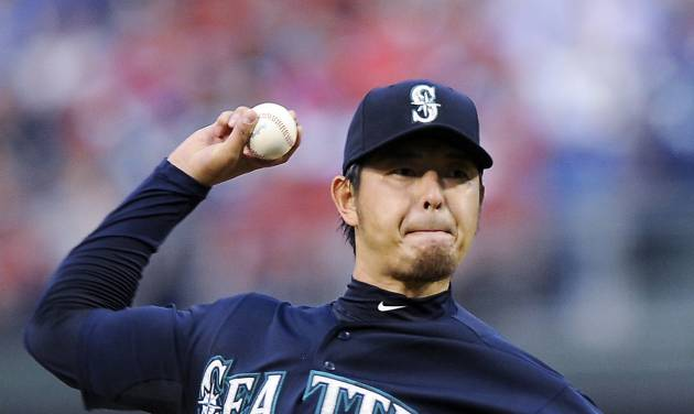 Seattle Mariners starting pitcher Hisashi Iwakuma throws a pitch in the first inning of an interleague baseball game against the Philadelphia Phillies on Tuesday, Aug. 19, 2014, in Philadelphia. (AP Photo/Michael Perez)