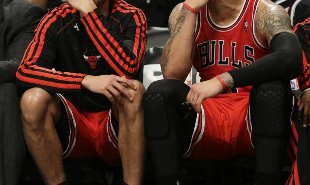 Chicago Bulls' Joakim Noah, left, and Carlos Boozer watch the end of the game against the Brooklyn Nets from the bench during the second half of Game 1 in the first round of the NBA basketball playoffs at the Barclays Center, Saturday, April 20, 2013, in New York. The Nets defeated the Bulls 106-89. (AP Photo/Seth Wenig)