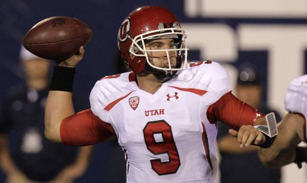 Utah quarterback Jon Hays (9)passes the ball during the fourth quarter of an NCAA football game with Utah State Friday, Sept. 7, 2012, in Logan, Utah. Utah State defeated Utah 27-20. (AP Photo/Rick Bowmer)