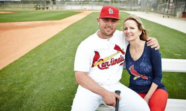 Cardinals' Matt Holliday sits with his mother Kathy during the 2013 spring training in Jupiter. They participated in the photo shoot for the Siteman Cancer Center, where Kathy Holliday was treated for colon cancer. Photo by Jay Fram courtesy of Siteman Cancer Center. Photo by St. Louis Post-Dispatch