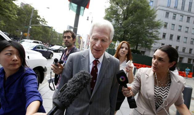 Mediator Daniel Pollack, center, leaves federal court after a hearing regarding Argentina's request to extend deadlines to repay a $1.65 billion debt to U.S. hedge funds, Friday, June 27, 2014, in New York.   Judge Thomas P. Griesa has ordered a U.S. bank to return a $539 million payment from Argentina, saying it was illegal to make. The order by the judge came Friday, three days before Argentina faces default if it fails to pay $832 million to the majority of its debt holders. (AP Photo/Jason DeCrow)