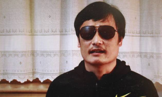 """In this image made from video, blind legal activist Chen Guangcheng is seen on a video posted to YouTube Friday, April 27, 2012 by overseas Chinese news site Boxun.com. """"I am now free. But my worries have not ended yet,"""" Chen said in the video that was recorded this week and that activists sent Friday to Boxun.com. Speaking to a camera in a room with an off-white curtain drawn behind him, Chen said, """"My escape might ignite a violent revenge against my family."""" (AP Photo/Boxun.com)"""