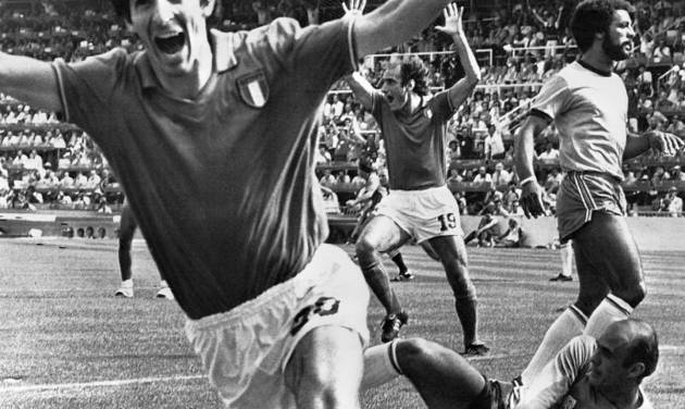 FILE - In this July 5, 1982 file photo, Italy's Paolo Rossi, left, celebrates, after scoring the second goal for his team during their World Cup match second round soccer match against Brazil, in Barcelona, Spain. Brazilian goalkeeper Valdir Perez, lies on pitch as defender Junior runs at right. On this day: Italy beats Brazil 3-2 in a classic World Cup match to progress to the semifinals. (AP Photo/File)