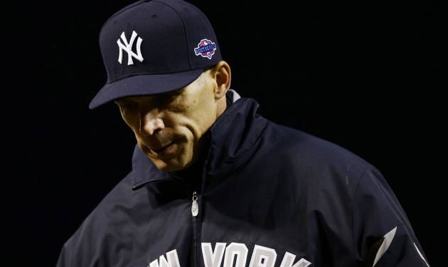 New York Yankees manager Joe Girardi walks off the field after speaking with an umpire in the first inning of Game 2 of the American League division baseball series against the Baltimore Orioles on Monday, Oct. 8, 2012, in Baltimore. Baltimore won 3-2. (AP Photo/Alex Brandon)