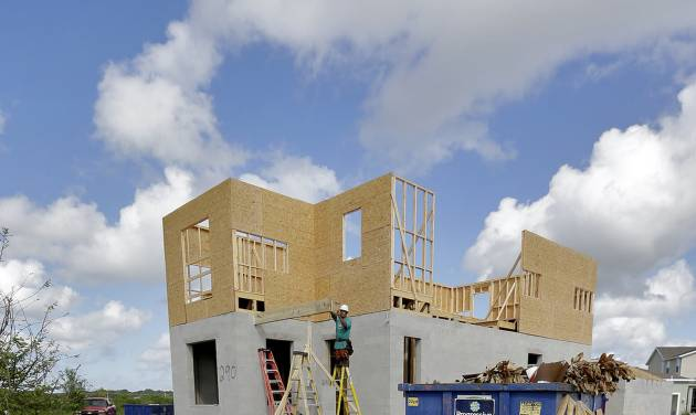 This May 15, 2014 photo shows new home under construction in the Winthrop sub-division in Riverview, Fla. The Commerce Department reports on U.S. home construction in June on Thursday, July 17, 2014. (AP Photo/Chris O'Meara)