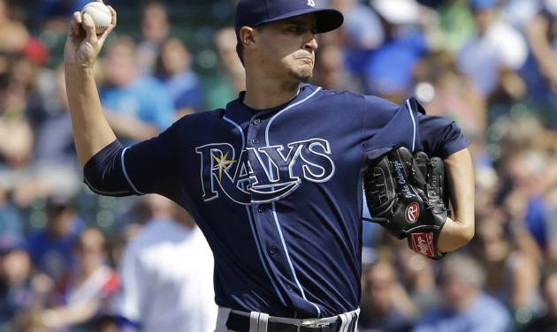 Tampa Bay Rays starter Jake Odorizzi throws against the Chicago Cubs during the first inning of an interleague baseball game in Chicago, Saturday, Aug. 9, 2014. (AP Photo/Nam Y. Huh)