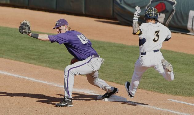 TCU first baseman Kevin Cron catches a throw from second for the TCU out in the sixth inning of a second-round game of the Big 12 conference NCAA college baseball tournament in Oklahoma City, Thursday, May 22, 2014. (AP Photo/Alonzo Adams)