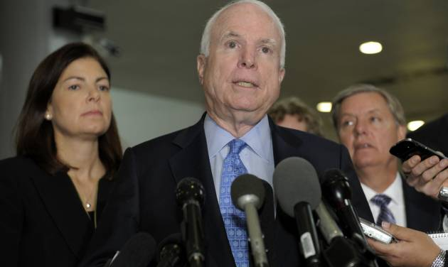 Sen. John McCain, R-Ariz., ranking Republican on the Senate Armed Services Committee, center, flanked by fellow committee members, Sen. Kelly Ayotte, R-N.H., left, and Sen. Lindsey Graham, R-S.C., right, speaks  on Capitol Hill in Washington, Tuesday, Nov. 27, 2012, following a meeting with UN Ambassador Susan Rice. Rice met with lawmakers to discuss statements she made about the attack on the U.S. Consulate in Libya that left the ambassador and three other Americans dead. (AP Photo/Susan Walsh)