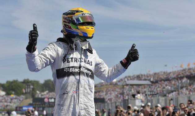 Mercedes driver Lewis Hamilton of Britain celebrates after winning the Hungarian Formula One race at the Hungaroring racetrack, near Budapest, Hungary, Sunday, July 28, 2013. (AP Photo/Bela Szandelszky)