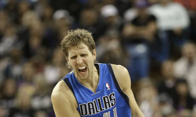 Dallas Mavericks forward Dirk Nowitzki, of Germany, celebrates after scoring a three-point shot in the fourth quarter against the Sacramento Kings in an NBA basketball game in Sacramento, Calif., Thursday, Jan. 10, 2012.  The Mavericks won in overtime 117-112.(AP Photo/Rich Pedroncelli