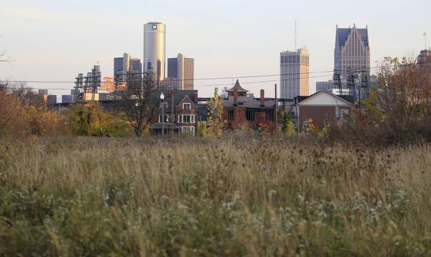 FILE - This Oct. 24, 2012 file photo shows an empty field north of Detroit's downtown. Detroit, which on Thursday, July 18, 2013, filed the largest municipal bankruptcy case in American history, owes as much as $20 billion to banks, bondholders and pension funds. The city can get rid of its gargantuan debt, but a bankruptcy judge can't bring back residents or raise its dwindling revenue. (AP Photo/Carlos Osorio, File)