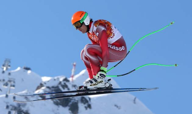 Switzerland's Sandro Viletta jumps during the downhill portion of the men's supercombined at the Sochi 2014 Winter Olympics, Friday, Feb. 14, 2014, in Krasnaya Polyana, Russia. (AP Photo/Luca Bruno)