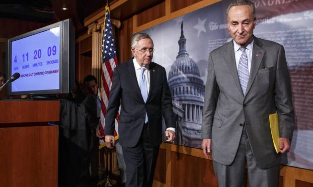 """Senate Majority Leader Harry Reid of Nev., left, follows Sen. Charles Schumer, D-N.Y., right, the Democratic Policy Committee chairman, after a news conference on Capitol Hill in Washington, Thursday, Sept. 26, 2013, after blaming conservative Republicans for holding up a stopgap spending bill to keep the government running. Senate passage of the spending bill — stripped of the """"Obamacare"""" provision — was expected no later than Saturday.  (AP Photo/J. Scott Applewhite)"""
