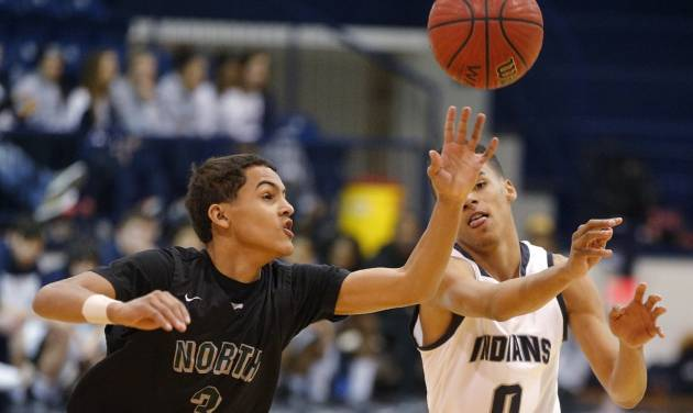 Norman North's Trae Young tips the ball as  El Reno's Justin Harris passes during a boys high school basketball game in Shawnee, Okla., Friday , Jan., 24, 2014. Photo by Bryan Terry, The Oklahoman