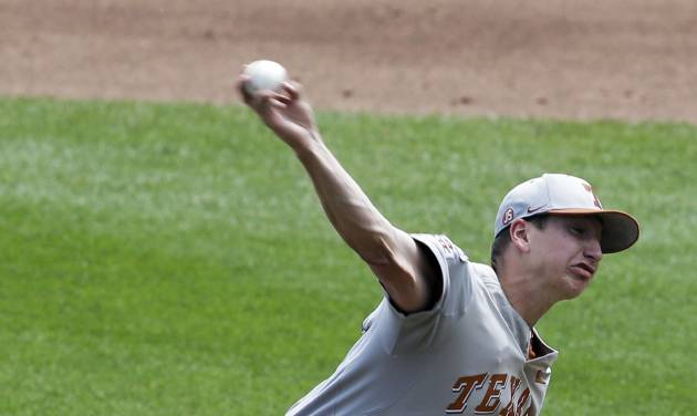 Texas starting pitcher Parker French works against Louisville in the first inning of an NCAA baseball College World Series elimination game in Omaha, Neb., Monday, June 16, 2014. (AP Photo/Nati Harnik)