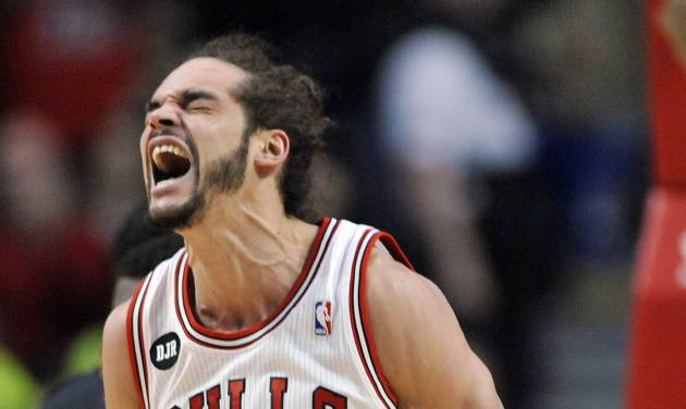 Chicago Bulls Joakim Noah reacts after being fouled by Miami Heat's Greg Oden during the first half of an NBA basketball game in Chicago, Sunday, March 9, 2014. (AP Photo/ Paul Beaty)