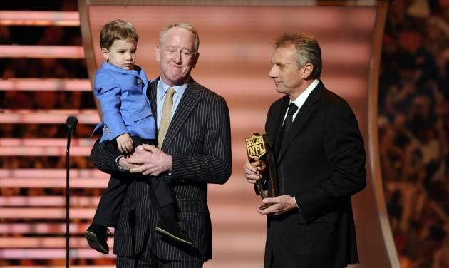 Former NFL quartetrback Joe Montana, right, presents the award for AP Most Valuable Player to Archie Manning and Marshall Manning, on behalf of Denver Broncos quarterback Peyton Manning, son of Archie Manning, at the third annual NFL Honors at Radio City Music Hall on Saturday, Feb. 1, 2014, in New York. (Photo by Evan Agostini/Invision for NFL/AP Images)