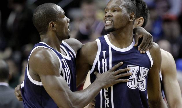 Oklahoma City Thunder center Serge Ibaka, left, walks teammate Kevin Durant away from the referee after Durant is called for a technical foul during the first half of an NBA basketball game against the Portland Trail Blazers in Portland, Ore., Tuesday, Feb. 11, 2014. (AP Photo/Don Ryan)