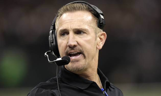 In this Sept. 9, 2012, photo, New Orleans Saints defensive coordinator Steve Spagnuolo watches during the first half of the Saints' NFL football game against the Washington Redskins in New Orleans. The Baltimore Ravens hired former Saints defensive coordinator Spagnuolo as a senior defensive assistant on Friday, May 3, 2013, offering Spagnuolo an opportunity at redemption following an unsettled 2012 season in which he oversaw a historically bad defense with scandal-plagued New Orleans. (AP Photo/Matthew Hinton)