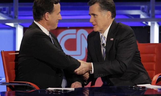 "FILE - In this Feb. 22, 2012, file photo Republican presidential candidate and former Massachusetts Gov. Mitt Romney, right, talks with fellow candidate, former Pennsylvania Sen. Rick Santorum, left, after a presidential debate in Arizona. On Monday night, May 7, 2012, Santorum endorsed Romney, saying ""above all else"" they agree that Obama must be defeated. (AP Photo/Jae C. Hong, File)"