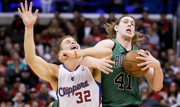Los Angeles Clippers forward Blake Griffin, left, battles Boston Celtics center Kelly Olynyk for a loose ball during the first half of an NBA basketball game in Los Angeles, Wednesday, Jan. 8, 2014. (AP Photo/Chris Carlson)