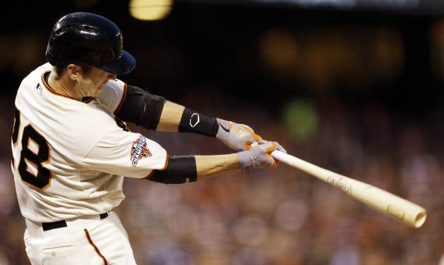 San Francisco Giants' Buster Posey singles during the fourth inning of a baseball game against the Milwaukee Brewers on Tuesday, Aug. 6, 2013, in San Francisco. (AP Photo/Marcio Jose Sanchez)