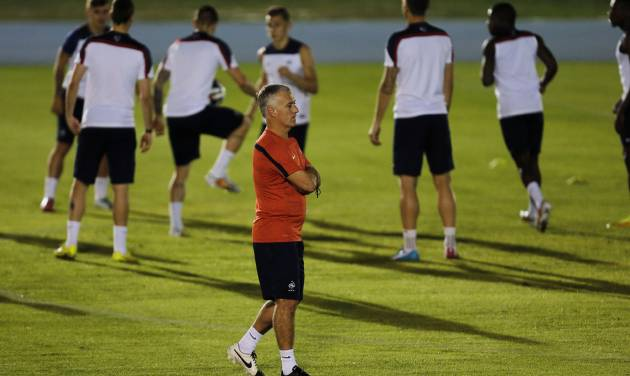 France's head coach Didier Deschamps walks on the field during an official training session at the Joao Havelange Olympic stadium, in Rio de Janeiro, Brazil, Tuesday, June 24, 2014. France will play its next game against Ecuador in group E of the 2014 soccer World Cup. A draw is enough to guarantee top spot for France, and would also send Ecuador through to the next round if Switzerland fails to beat Honduras in the other match. (AP Photo/David Vincent)