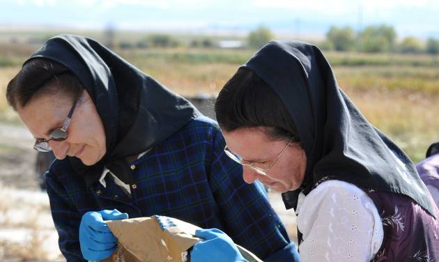 "This undated image released by National Geographic Channels shows Hutterites Rita Hofer and Sarah Hofer pouring lye for soap in King Colony, Mont. ""Meet the Hutterites,"" a National Geographic documentary series about a small religious colony in rural Montana, debuts Tuesday, May 29. (AP Photo/National Georgraphic, Ben Shank)"