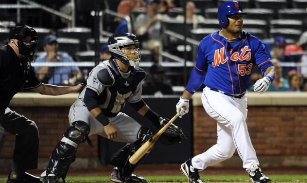 New York Mets' Bobby Abreu (53) hits an RBI single off of San Diego Padres starting pitcher Andrew Cashner as Rene Rivera catches for the Padres in the fifth inning of a baseball game at Citi Field on Friday, June 13, 2014, in New York. (AP Photo/Kathy Kmonicek)