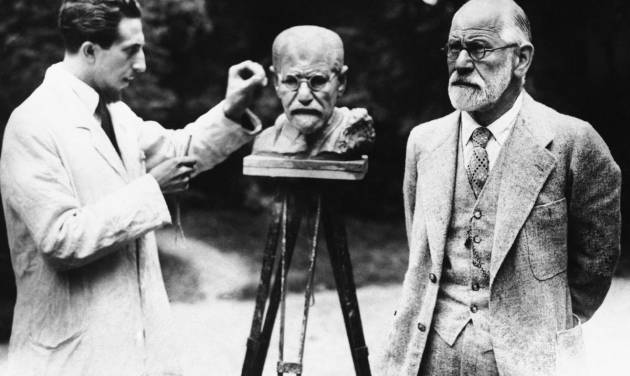 FILE - This is a 1931 file photo of Sigmund Freud, father of psychoanalysis, as he poses for sculptor Oscar Nemon in Vienna. British police are hunting burglars who tried to steal the ashes of psychoanalyst Sigmund Freud from a London crematorium. The Metropolitan Police force says a 2,300-year-old Greek urn containing the remains of Freud and his wife Martha was severely damaged in a break-in at Golders Green Crematorium on Dec. 31 or Jan. 1. (AP Photo/File)