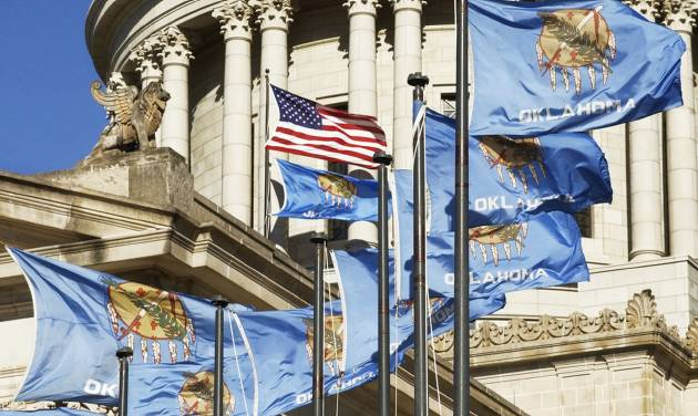"Flags flap in the wind at the state Capitol. Rep. Shane Jett authored a bill to italicize ""OKLAHOMA"" on the flag and add an exclamation point.  OKLAHOMA ARCHIVE PHOTO"