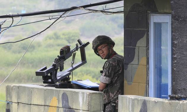 A South Korean soldier stands guard at a military checkpoint near the border village of Panmunjom, which has separated the two Koreas since the Korean War, in Paju, South Korea, Saturday, June 7, 2014. North Korea has detained a 56-year old man from Ohio, accusing him of an unspecified crime after he traveled to the communist-led country as a tourist, the nation's state news agency and the man's family said Friday. (AP Photo/Ahn Young-joon)