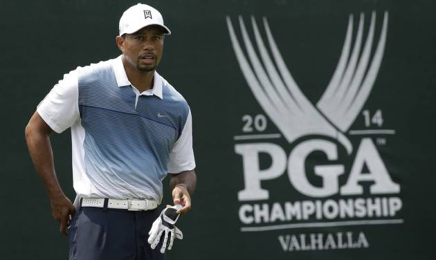 Tiger Woods stands on the first tee during a practice round for the PGA Championship golf tournament at Valhalla Golf Club on Wednesday, Aug. 6, 2014, in Louisville, Ky. The tournament is set to begin on Thursday. (AP Photo/David J. Phillip)