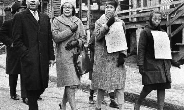 Dr.  Martin  Luther  King,  Jr., left, and his wife, Coretta Scott  King, second from left, join pickets during a tour of an Atlanta slum area, in this Feb. 1, 1966 file photo. (AP Photo)