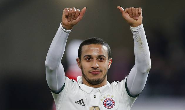 Bayern's Thiago Alcantara of Spain celebrates after winning the German first division Bundesliga soccer match between Hannover 96 and Bayern Munich in Hannover, Germany, Sunday, Feb. 23, 2014. (AP Photo/Frank Augstein)