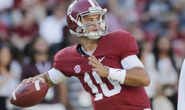 FILE - In this Sept. 28, 2013 file photo, Alabama quarterback AJ McCarron (10) warms up prior to an NCAA college football game against Mississippi in Tuscaloosa, Ala. McCarron made a pact with himself: He wouldn't go to New York before he's able to pay his own way unless it's for the Heisman Trophy ceremony or the NFL draft. He's headed there this weekend as a Heisman finalist.(AP Photo/Dave Martin, File)