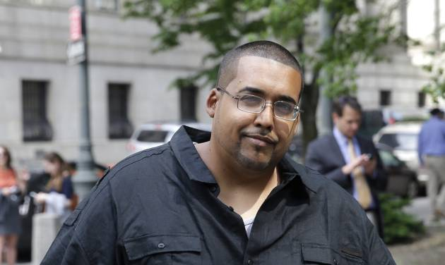 Hector Xavier Monsegur arrives at court in New York for a sentencing hearing Tuesday, May 27, 2014. Monsegur, a prolific computer hacker who infiltrated the servers of major corporations, later switched sides to helped the U.S. government disrupt hundreds of cyberattacks on Congress, NASA and other sensitive targets, according to federal prosecutors. After his arrest and guilty plea in 2011, he faced more than two decades behind bars. But because of his cooperation, the sentence could be two years or less.  (AP Photo/Seth Wenig)