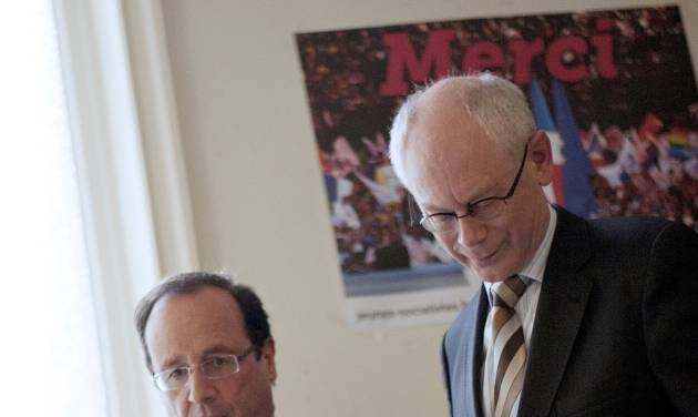 France's president-elect Francois Hollande, left, walks down stairs with European Council President Herman Van Rompuy after a meeting at his campaign headquarters in Paris, Wednesday, May 9, 2012. (AP Photo/Fred Dufour, Pool)