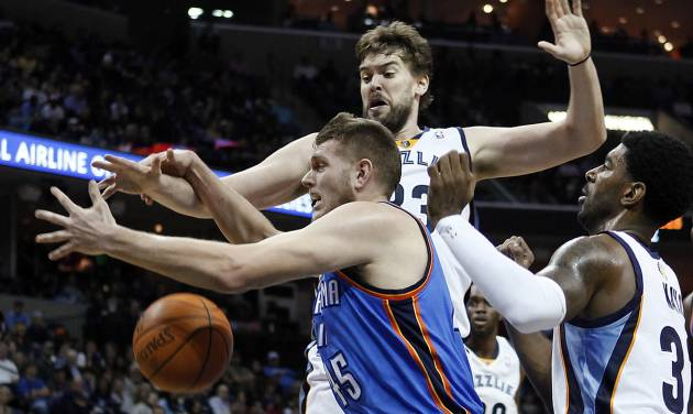 Memphis Grizzlies' Marc Gasol, back, and O.J. Mayo, right, try to get a rebound against Oklahoma City Thunder center Cole Aldrich (45) in the first half of an NBA basketball game Wednesday, Dec. 28, 2011, in Memphis, Tenn. The Thunder won 98-95. (AP Photo/Lance Murphey) ORG XMIT: TNLM110