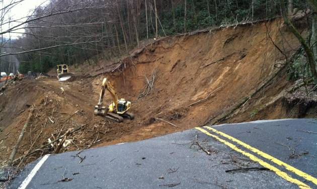 CORRECTS SOURCE AND REMOVES BYLINE - In this photo provided by the Great Smoky Mountains National Park, work to repair a landslide that took out a section of a Smoky Mountains highway between Newfound Gap and Smokemount, Tenn. is underway on Tuesday, Jan. 29, 2013. (AP Photo/Great Smoky Mountains National Park)